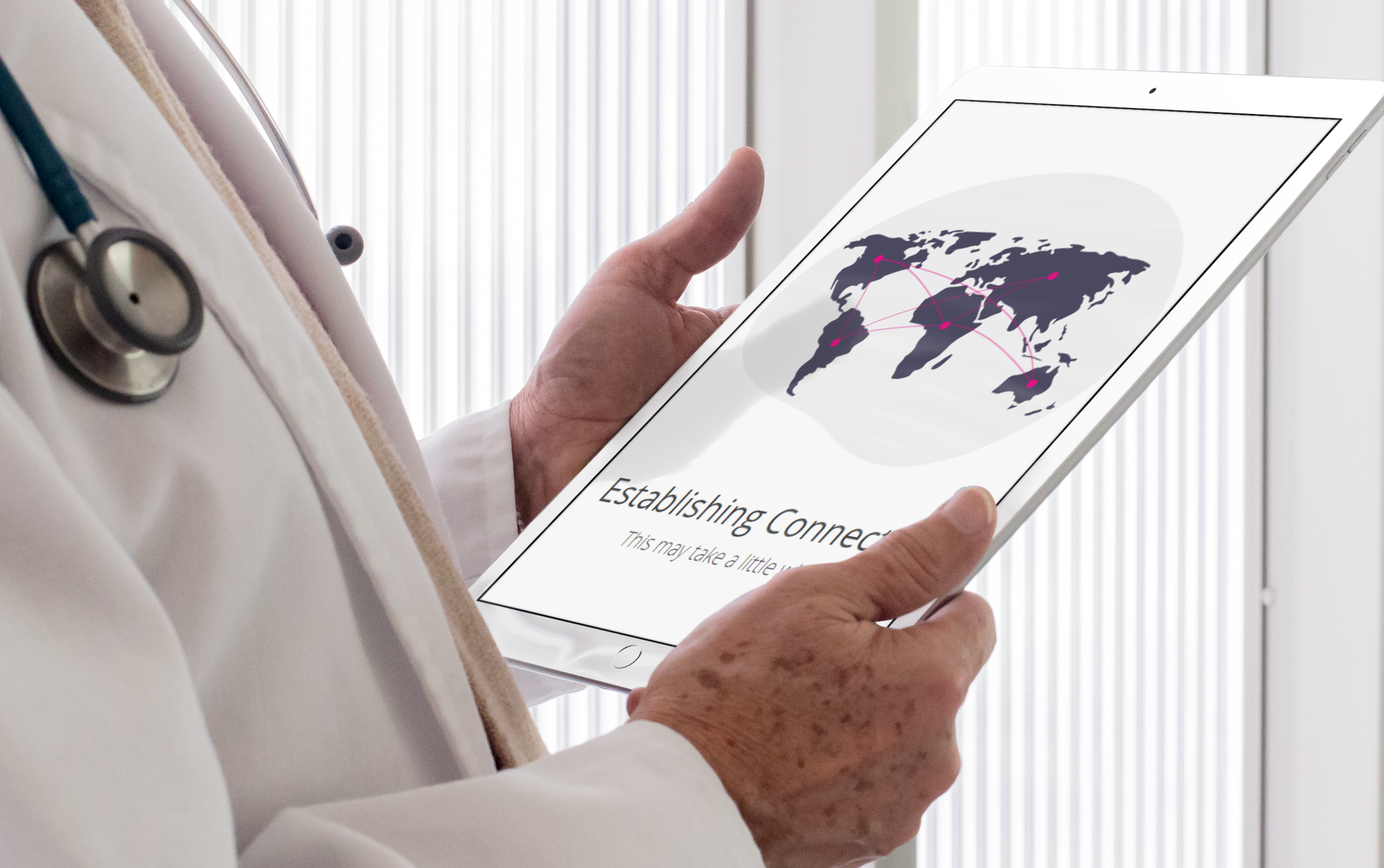 ipad-mockup-of-a-senior-doctor-holding-his-ipad-pro-a12441wide - CROP